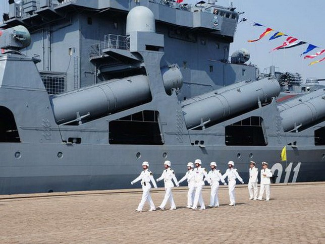 Chinese sailors march past a visiting Russian destroyer, Admiral Vinogradov, berthed at the People's Liberation Army (PLA) naval base in Qingdao, China prior to joint naval exercises in 2012. The Chinese and Russian militaries will hold their latest joint exercises in August in the Sea of Japan. Photo: STRA/AFP/Getty Images