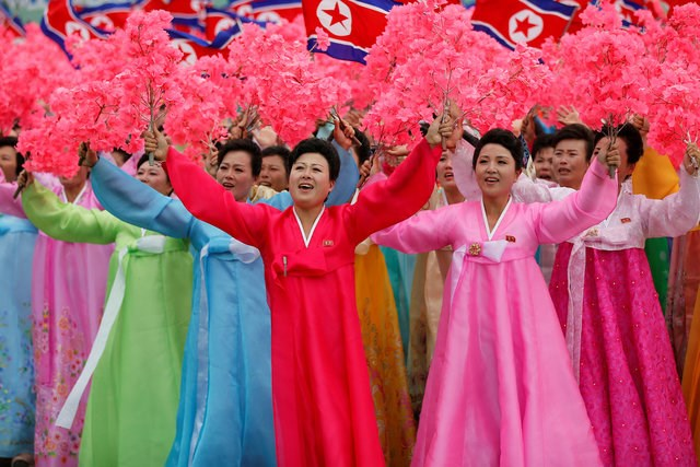 People react as they see North Korean leader Kim Jong Un during a mass rally and parade in the capital's main ceremonial square, a day after the ruling party wrapped up its first congress in 36 years by elevating him to party chairman, in Pyongyang, North Korea, May 10, 2016. Photo: Reuters /Damir Sagolj