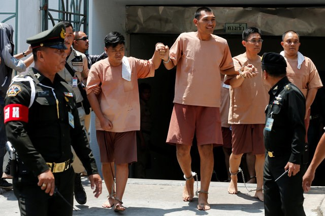 Activists who were detained after posting critical comments on Facebook of the ruling military junta leave a military court in Bangkok, Thailand, May 10, 2016. Photo: Reuters/Chaiwat Subprasom/File Photo