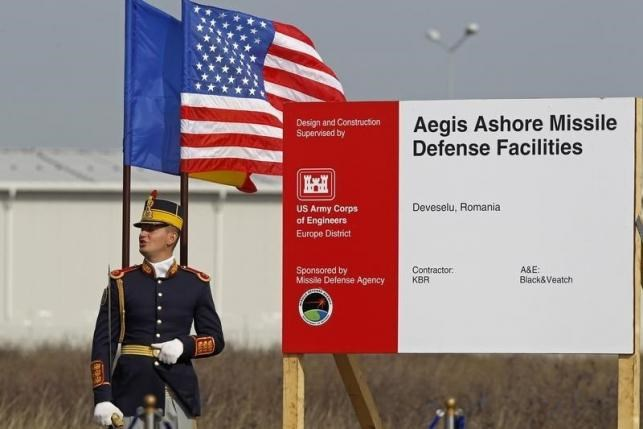 A Romanian soldier attends the official ground breaking ceremony of the site for the U.S. Aegis Ashore missile defense facility, located in a former airbase on Deveselu that will form part of a shield to protect Europe, next to Deveselu village, 182 km east of Bucharest, October 28, 2013. Photo: Reuters/Bogdan Cristel