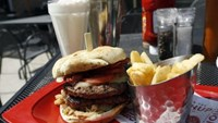 A meal of a ''Monster''-sized A.1. Peppercorn burger, Bottomless Steak Fries, and Monster Salted Caramel Milkshake is seen at a Red Robin restaurant in Foxboro, Massachusetts July 30, 2014. Photo: Reuters/Dominick Reuter
