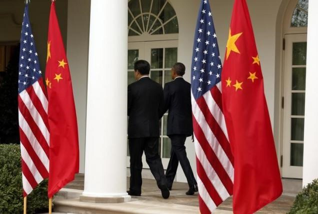 China's President Xi Jinping (L) and U.S. President Barack Obama depart at the end of a joint news conference in the Rose Garden at the White House in Washington September 25, 2015. Photo: Reuters/Kevin Lamarque