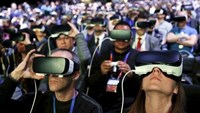 People wear Samsung Gear VR devices as they attend the launching ceremony of the new Samsung S7 and S7 edge smartphones during the Mobile World Congress in Barcelona, Spain, February 21, 2016. Photo: Reuters/Albert Gea