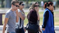 Unidentified relatives and friends of passengers who were flying in an EgyptAir plane that vanished from radar en route from Paris to Cairo react as they wait outside the Egyptair in-flight service building where relatives are being held at Cairo International Airport, Egypt May 19, 2016. Photo: Reuters/Amr Abdallah Dalsh