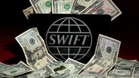 The SWIFT logo is pictured in this photo illustration taken April 26, 2016. Photo: Reuters/Carlo Allegri/Illustration/File Photo