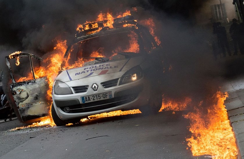 Demonstrators burn a police car on May 18, 2016. Photo: Cyrielle Sicard/AFP via Getty Images