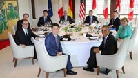 Participants of the G7 summit meetings (from front in clockwise) Japanese Prime Minister Shinzo Abe, French President Francois Hollande, Britain's Prime Minister David Cameron, Canadian Prime Minister Justin Trudeau, European Commission President Jean-Claude Juncker, European Council President Donald Tusk, Italy's Prime Minister Matteo Renzi, German Chancellor Angela Merkel and U.S. President Barack Obama attend session 1 working lunch meeting at the Shima Kanko Hotel in Shima, Mie Prefecture, J
