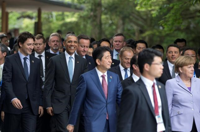 From left, Canadian Prime Minister Justin Trudeau, U.S. President Barack Obama, British Prime Minister David Cameron, Japanese Prime Minister Shinzo Abe, European Council President Donald Tusk, Italian Prime Minister Matteo Renzi, and German Chancellor Angela Merkel walk to a tree planting ceremony as they visit the Ise Jingu shrine in Ise, Mie Prefecture, Japan, Thursday, May 26, 2016, as part of the G-7 Summit. Photo: Reuters/Carolyn Kaster/Pool