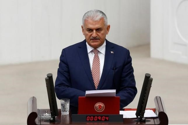 Turkey's new Prime Minister Binali Yildirim reads his government's programme at the Turkish parliament in Ankara, Turkey, May 24, 2016.Photo: Reuters/Umit Bektas