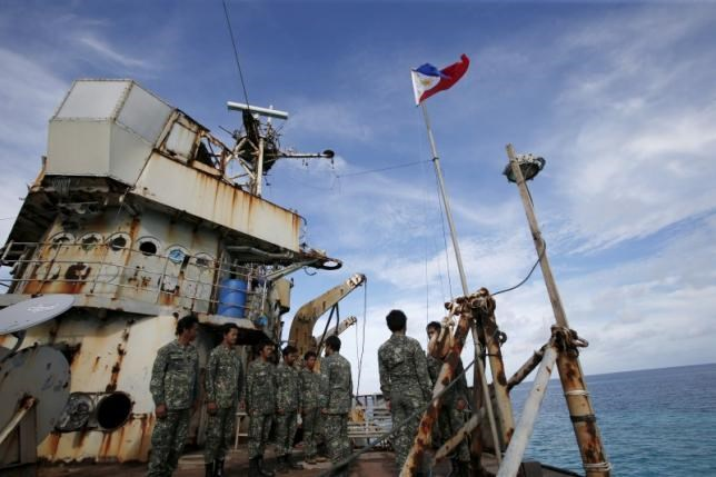 Members of Philippine Marines is pictured at BRP Sierra Madre, a dilapidated Philippine Navy ship that has been aground since 1999 and became a Philippine military detachment on the disputed Second Thomas Shoal, part of the Spratly Islands, in the South China Sea March 29, 2016. Reuters/Erik De Castro