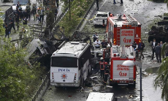 Fire engines stand beside a Turkish oplice bus which awas targeted in a bomb attack in a central Istanbul district, Turkey, June 7, 2016. Photo: Reuters/Osman Orsal