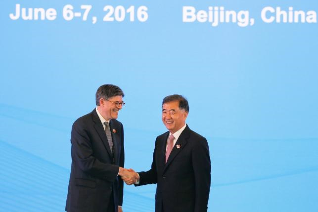 U.S. Treasury Secretary Jack Lew shakes hands with China's Vice Premier Wang Yang before the Economic Dialogue of the 8th round of U.S.-China Strategic and Economic Dialogues in Beijing June 6, 2016. Photo: Reuters/Damir Sagolj