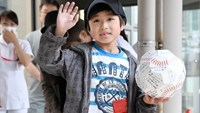Seven-year-old Yamato Tanooka, who was found by authorities in the woods nearly a week after his parents abandoned him for disciplinary reasons, waves as he leaves a hospital in Hakodate on the northernmost Japanese main island of Hokkaido, Japan, in this photo taken by Kyodo on June 7, 2016. Photo credit Kyodo/via Reuters