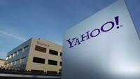 A Yahoo logo is pictured in front of a building in Rolle, 30 km (19 miles) east of Geneva, December 12, 2012. Photo: Reuters/Denis Balibouse/File photo