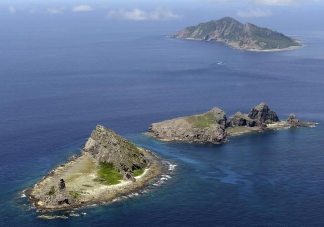 A group of disputed islands, Uotsuri island (top), Minamikojima (bottom) and Kitakojima, known as Senkaku in Japan and Diaoyu in China is seen in the East China Sea, in this photo taken by Kyodo September 2012. Photo credit: Reuters/Kyodo