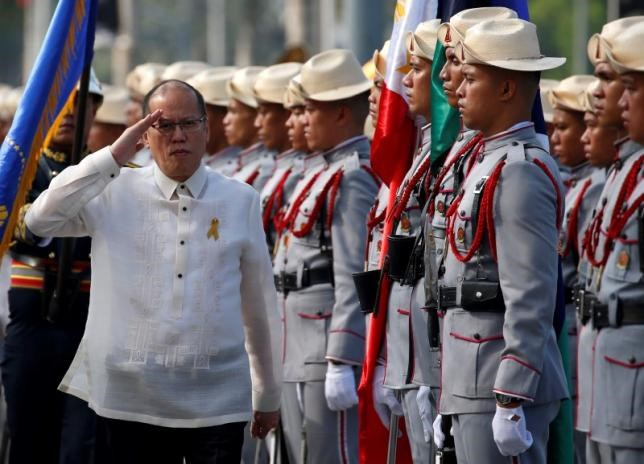 Benigno Aquino salutes the honour guard during the Independence Day celebration, two weeks before Aquino will relinguish his post to newly elected President Rodrigo Duterte (not pictured) in Manila, Philippines June 12, 2016. Photo: Reuters/Erik De Castro