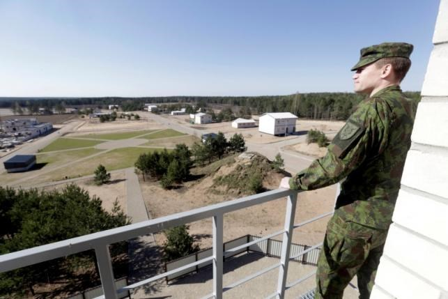 Lithuanian army officer Nerijus Rocevicius looks at construction site of the newly built training premises for urban warfare in Pabrade, Lithuania, April 28, 2016. Photo: Reuters/Ints Kalnins/File Photo