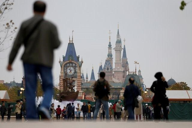 People visit Disney Town of Shanghai Disney Resort in Shanghai, China, April 26, 2016. Reuters/Aly Song/File Photo