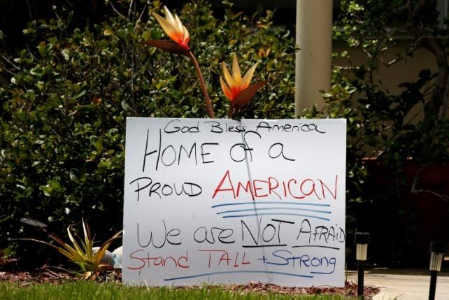 A sign is pictured in front of a house across the street from Omar Mateen's home in Port Saint Lucie, Florida, U.S. June 14, 2016. Photo: Reuters/Carlo Allegri