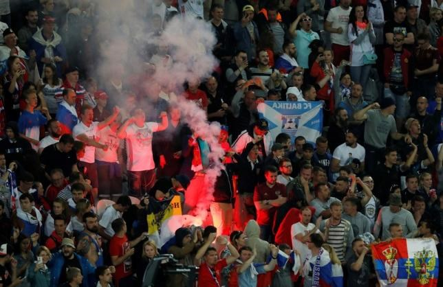 Fans with a flare during the Russia v Slovakia match at Stade Pierre-Mauroy, Lille, Franc on June 15, 2016. Photo: Reuters/Benoit Tessier