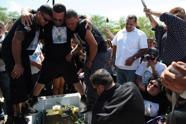 Family and friends attend the funeral of Angel Candelario, one of the victims of the shooting at the Pulse night club in Orlando, at his hometown of Guanica, Puerto Rico, June 18, 2016. Photo: Reuters/Alvin Baez