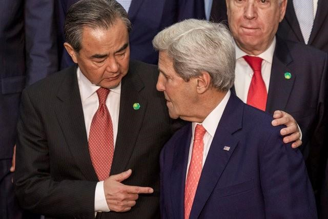 Chinese Foreign Minister Wang Yi (L) speaks with U.S. Secretary of State John Kerry in Paris, France, Friday, June 3, 2016. Photo: Reuters/Kamil Zihnioglu/Pool