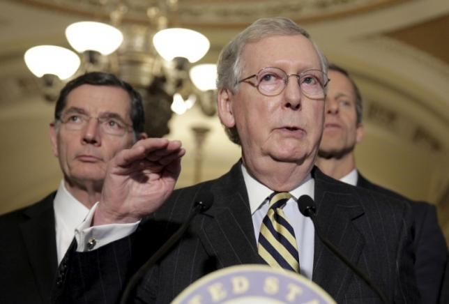 Senate Majority Leader Mitch McConnell (R-KY) speaks during a news conference as Senator John Barrasso (R-WY) listens on Capitol Hill in Washington March 8, 2016. Photo: Reuters/Joshua Roberts