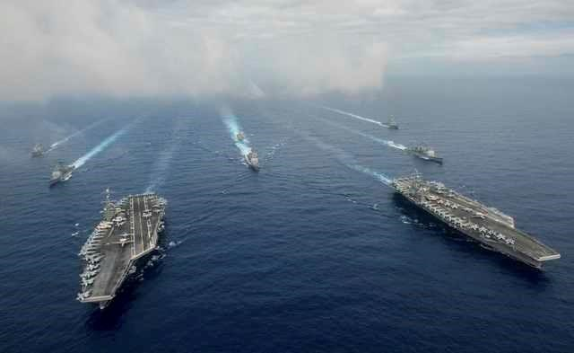 The Nimitz-class aircraft carriers USS John C. Stennis (CVN 74), and USS Ronald Reagan (CVN 76) (R) conduct dual aircraft carrier strike group operations in the U.S. 7th Fleet area of operations in support of security and stability in the Indo-Asia-Pacific in the Philippine Sea on June 18, 2016. Photo courtesy Jake Greenberg/U.S. Navy/Handout via Reuters