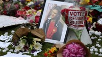 Tributes in memory of murdered Labour Party MP Jo Cox, who was shot dead in Birstall, are left at Parliament Square in London. Photo: Reuters/Neil Hall