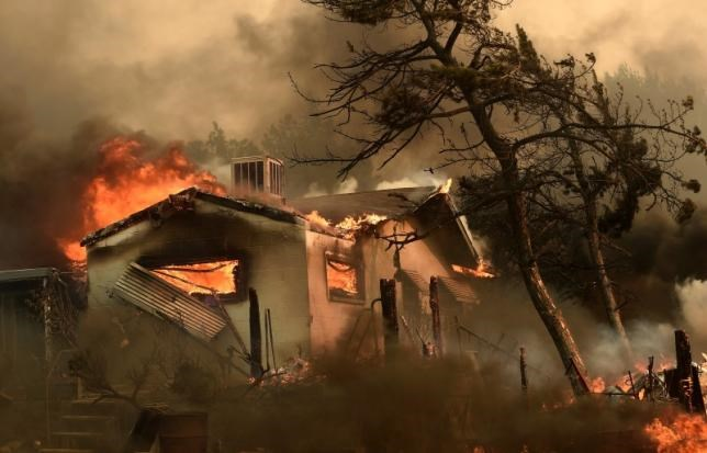 Flames from the Erskine Fire engulf a home near Weldon, California, U.S. June 24, 2016. Photo: Reuters/Noah Berger