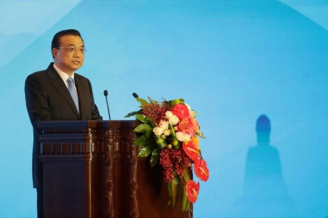 China's Premier Li Keqiang delivers a speech at the First World Conference on Tourism for Development at the Great Hall of the People in Beijing, China, May 19, 2016. Photo: Reuters/Jason Lee