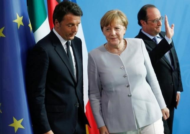 German Chancellor Angela Merkel (C), French President Francois Hollande (R) and Italian Prime Minister Matteo Renzi attend a news conference at the chancellery during discussions on the outcome of the Brexit in Berlin, Germany, June 27, 2016. Photo: Reuters/Hannibal Hanschke