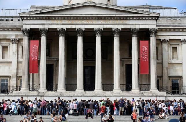 ourists gather outside the National Gallery, London August 4, 2015.