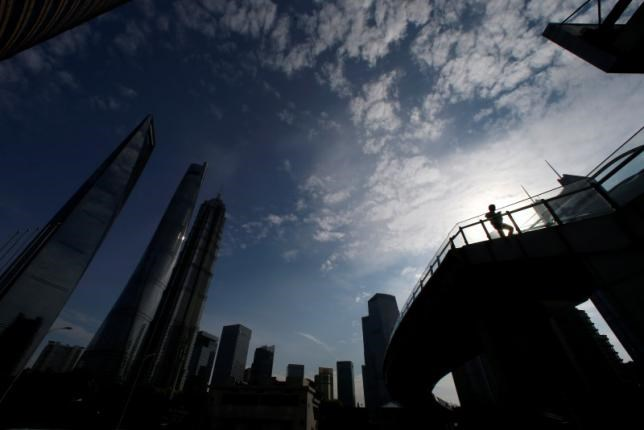 A man walks on a bridge in the financial district of Pudong in Shanghai, China June 22, 2016. Photo: Reuters/Aly Song