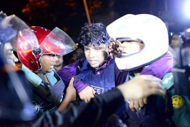 An injured member of the police personnel is carried away by his colleagues, after gunmen stormed a restaurant popular with expatriates in the diplomatic quarter of the Bangladeshi capital, in Dhaka July 1, 2016. Courtesy of Dhaka Tribune/Mahmud Hossain Opu via Reuters