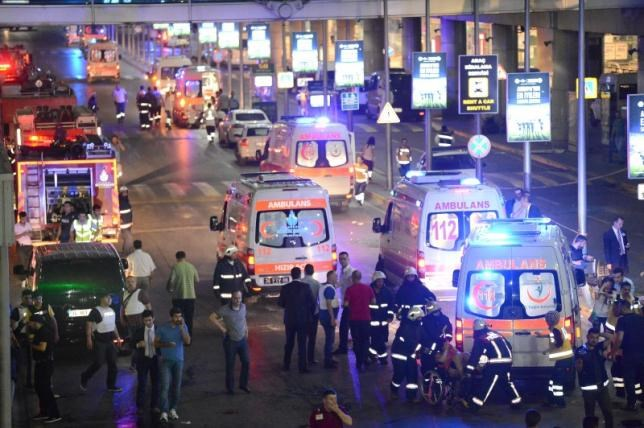 Paramedics help casualties outside Turkey's largest airport, Istanbul Ataturk. Photo: Reuters/Ismail Coskun/IHLAS News Agency