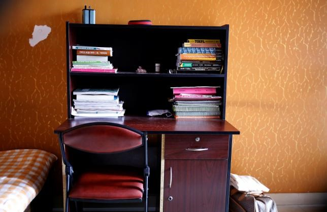 The study table of Meer Saameh Mubasheer is pictured in his room at his family home, in Dhaka, Bangladesh, July 5, 2016. Photo: Reuters/Mohammad Ponir Hossain