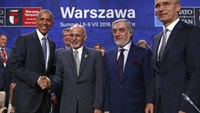 U.S. President Barack Obama (L) shakes hands with Afghanistan's President Ashraf Ghani next to NATO Secretary General Jens Stoltenberg (R) and Afghanistan's Chief Executive Abdullah Abdullah at the NATO Summit in Warsaw, Poland July 9, 2016. Photo: Reuters/Kacper Pempel