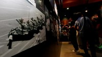A photo of 'Tank Man' is displayed inside the June 4th Museum, which commemorates the 1989 crackdown on protesters in Beijing's Tiananmen Square, during its last day of opening in Hong Kong, China July 11, 2016. Photo: Reuters/Bobby Yip
