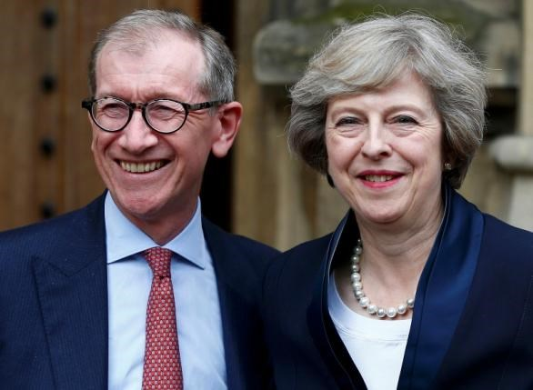 Theresa May emerges with her husband Philip to speak to reporters after being confirmed as the leader of the Conservative Party and Britain's next Prime Minister outside the Houses of