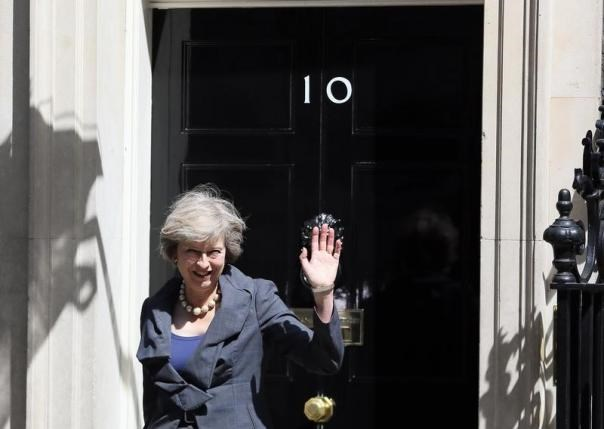 Britain's Home Secretary Theresa May, who is due to take over as prime minister on Wednesday, waves as she leaves after a cabinet meeting at number 10 Downing Street, in central London, Britain July 12, 2016. Photo: Reuters/Neil Hall