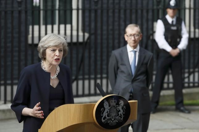 Britain's Prime Minister, Theresa May, watched by husband Philip, speaks to the media outside number 10 Downing Street, in central London, Britain July 13, 2016. Photo: Reuters/Stefan Wermuth