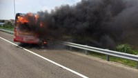 This handout photo taken and released by the Taoyuan City Fire Department on July 19, 2016 shows a bus carrying tourists from mainland China on fire after it crashed along an expressway on its way to the airport in Taiwan's city of Taoyuan on July 19, 2016. Photo credit: AFP / Taoyuan City Fire Department