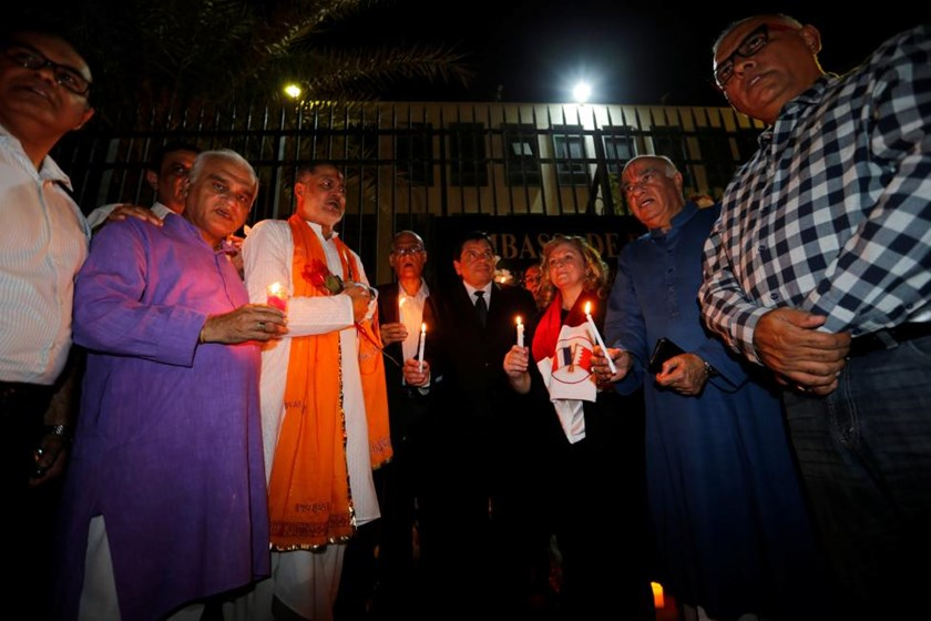 French Ambassador to Bahrain, Bernard Regnauld-fabre (5th L) holds a candle along with Bahraini's Hindu community members during a candle vigle held at the French Embassy in Manama to condemn and mourn the attack in Nice, France, where a driver of a heavy truck ran into a crowd on Bastille Day killing at least 84 people, July 16, 2016. Photo: Reuters/Hamad I Mohammed