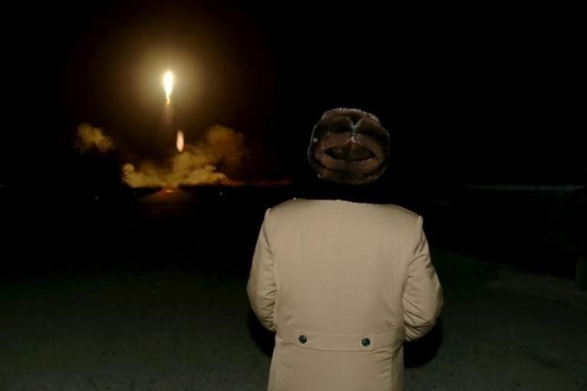 North Korean leader Kim Jong Un watches the ballistic rocket launch drill of the Strategic Force of the Korean People's Army (KPA) at an unknown location, in this undated file photo released by North Korea's Korean Central News Agency (KCNA) in Pyongyang in March 2016. Photo: Reuters/File Photo