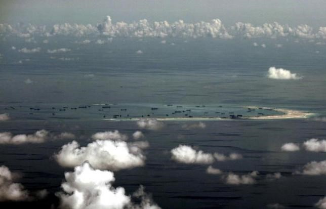 An aerial photo taken though a glass window of a Philippine military plane shows the alleged on-going land reclamation by China on mischief reef in the Spratly Islands in the South China Sea, west of Palawan, Philippines, May 11, 2015. Photo: Reuters/Ritchie B. Tongo/Pool