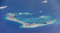 Chinese dredging vessels are purportedly seen in the waters around Mischief Reef in the disputed Spratly Islands in the South China Sea in this still image from video taken by a P-8A Poseidon surveillance aircraft provided by the United States Navy May 21, 2015. U.S. Photo: Navy/Handout via Reuters/File Photo