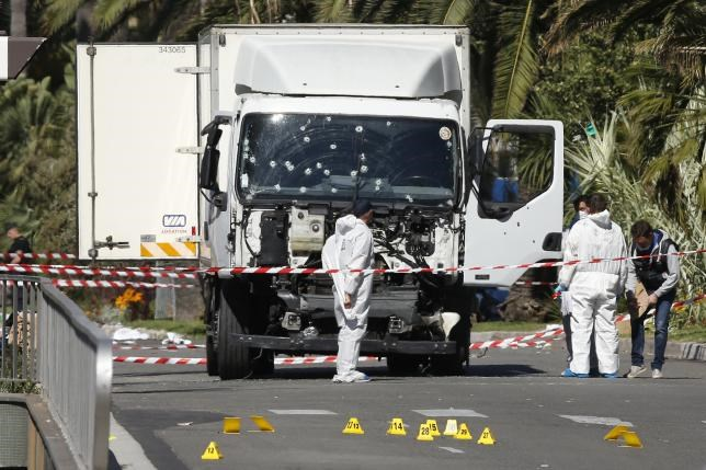 Investigators continue to work at the scene near the heavy truck that ran into a crowd at high speed killing scores who were celebrating the Bastille Day July 14 national holiday on the Promenade des Anglais in Nice, France, July 15, 2016. Photo: Reuters/Eric Gaillard