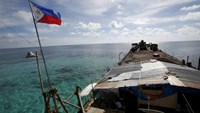 A Philippine flag flutters from BRP Sierra Madre, a dilapidated Philippine Navy ship that has been aground since 1999 and became a Philippine military detachment on the disputed Second Thomas Shoal, part of the Spratly Islands, in the South China Sea March 29, 2014. Photo: Reuters/Erik De Castro