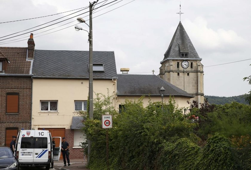French CRS police secure a street near the church after a hostage-taking in Saint-Etienne-du-Rouvray near Rouen in Normandy, France, July 26, 2016. A priest was killed with a knife and another hostage seriously wounded in an attack on a church that was carried out by assailants linked to Islamic State. Photo: Reuters/Pascal Rossignol
